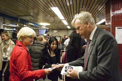 "An April 2010 photo shows David Miller distributing ""Save Transit City"" buttons at Eglinton station. That woman on the left sure looks familiar. (Photo by Brad Pritchard / InsideToronto)"